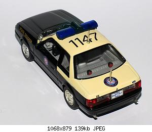 2008_1/7_-_1991_ford_mustang_lx_5.0l_ssp_florida_highway_patrol_white_rose_collectibles_-_2.jpg